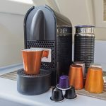 Nespresso-coffee-maker-machine-with-mug-cups-and-capsule-pods