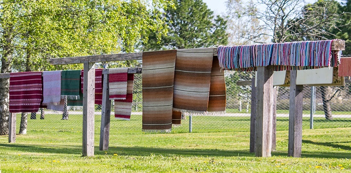Panoramic-view-of-carpets-hanging-to-dry-after-being-washed